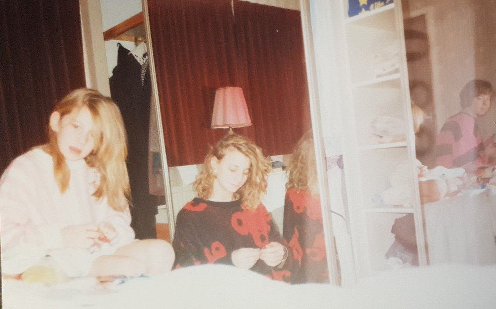 Me and my sisters opening our Christmas stockings in our parents room, circa 1987. That hair. Those jumpers. We were so cool.